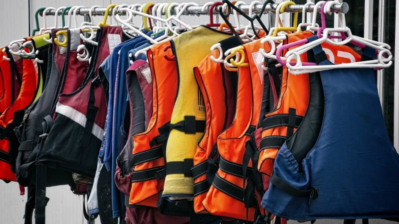 Rack of life vests to signify 401k vesting rules.
