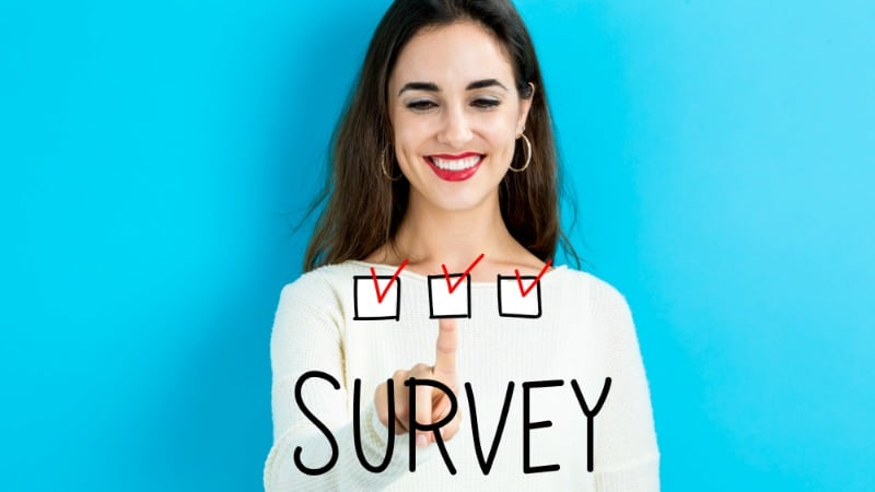 woman selecting an option for survey junkie review