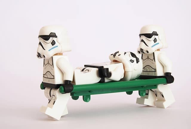 how does an hsa work: lego stormtroopers carrying one of their wounded