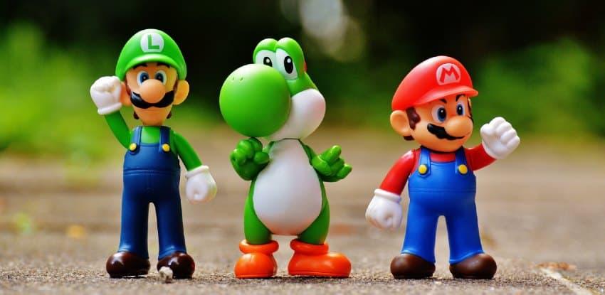 Mario, Luigi, and Yoshi celibrating a victory
