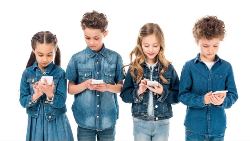 Group of kids staring at their smartphones